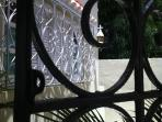 Dining room Gate leads to the the back yard surrounded by 7 mango trees, parking and gardens