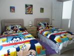 Twin bedded room has themed covers for the children