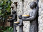 Baan Surin Sawan - Front entrance wall statues