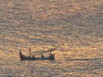 The Istana - Sunset fishing boat