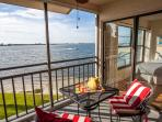 Relax on your balcony watching the dolphins, boats, and sea birds go by