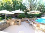 BBQ Station, Bar Station, Fire Pit, Tropical Swimming Pool & Tropical counters with umbrella shades.
