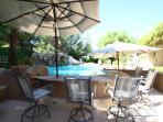 Swimming Pool, Tropical Bar Counter, Spa, and waterfall with umbrella shades..