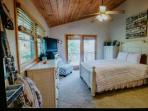 upstairs master with french doors leading to upper deck