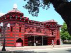 The most iconic building in all P. R., the Parque de Bombas, Firehall butting into the cathedral.
