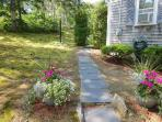 From the driveway head out back to the patio and sunroom entry - 11 Marshview Road Chatham Cape Cod New England...