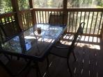 Screened porch.  Patio seating for 4
