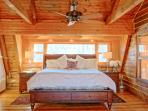 Herons Hideaway (2nd floor) views the bay. King bed and attached room with daybed