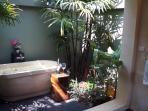 Tropical bathroom with lush greenery