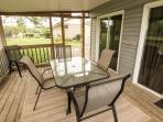 The screened in back porch is a great place to escape the summer sun and catch the lake breeze.
