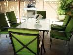 BBQ grill and outdoor dining table in patio