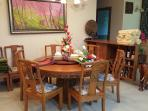 Hand carved teak dining set.