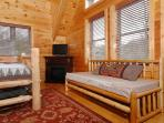 Twin daybed, electric fireplace, flat screen TV