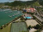 Arial view of tennis courts, pool and part of the Marina