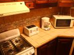 Kitchen detail, gas stove with oven, cabinets