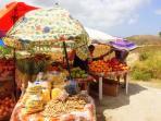 Roadside stands sell fresh mango and papaya