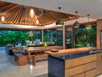 Open plan and open air kitchen, dining and living space