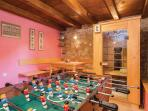 Football table and sauna in the ground playroom.