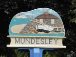 Mundesley is a pretty village  with pubs, shops and beach