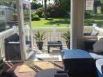 Patio door to allow access onto the decking and lots of light into the caravan.