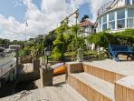 The decking area of the garden (left hand side of the slipway)
