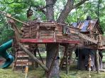 Children's Play area Tree House-Pirate ship, with slides, zip lines, swings, rock wall