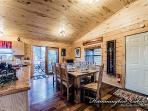 Dining area with access to back deck.