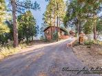 Paved driveway to cabin on the mountain