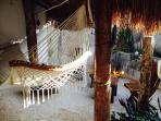 Back garden lounge area, hammock under palapa