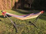 Relax and read in a hammock, as the kids explore the yard