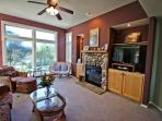 Lower level living room with a flat screen satellite TV/Blu-Ray DVD player, surround sound, CD player with MP3 jack...