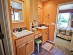 Lower level master bathroom with his & her vanities, Jacuzzi tub, stall shower and walk-in closet