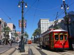 Hop on the riverfront streetcar to take you to Canal Street.