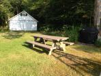 sprawling yard for croquet or a game of tag.  picnic table to enjoy a bbq