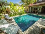 You can tan at crystal blue water in front the villa