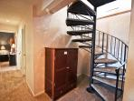 Spiral staircase leading to lower level bedrooms