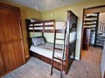 Lower level bedroom with a Queen Murphy bed and Twin bunk bed, slider to sunroom