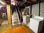 Basement with washer/dryer.