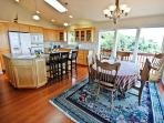Fully equipped kitchen with all appliances, large prep island with sink, breakfast bar for three, and dining table for...