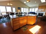 Fully equipped kitchen with all appliances, large prep island with sink, breakfast bar for three with spectacular ocean...