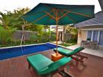 sun tan on the pool deck on comfortable sun beds