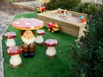The kids will love the play area with a large sandpit and gnome table with seats
