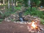 Enjoy waterfall and campfire in the back yard.