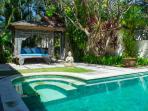 Cozy gazebo with swimming pool view
