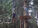 Tree adventure rope climbing for adults and children in woods opposite Les Trappeurs