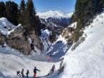Fun skiing in one of the many twisting turning canyons in La Plagne!