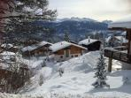 View of the chalet from behind with the 4 vallees ski area across the Rhone valley
