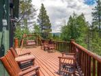 Evergreen's expansive back deck that backs up to the the town's largest park - 19 wooded acres!