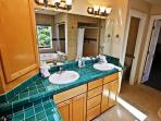Large master bathroom with his & her sinks, vanity area, two person Jacuzzi tub and dual head tiled shower.r.