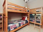 Second bedroom on the main level with two sets of twin bunks